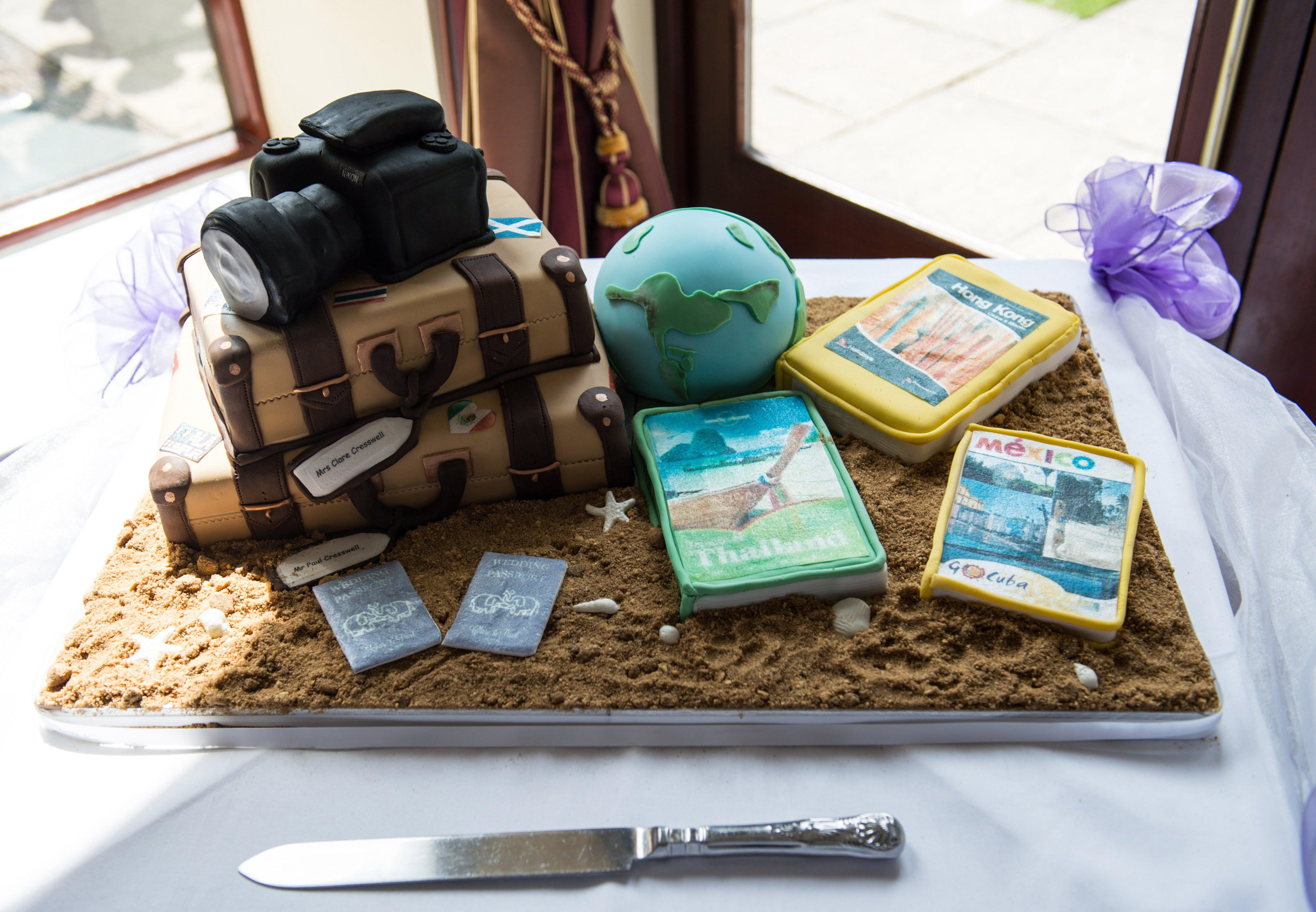 Travel theme wedding cake. Camera and Suitcase.