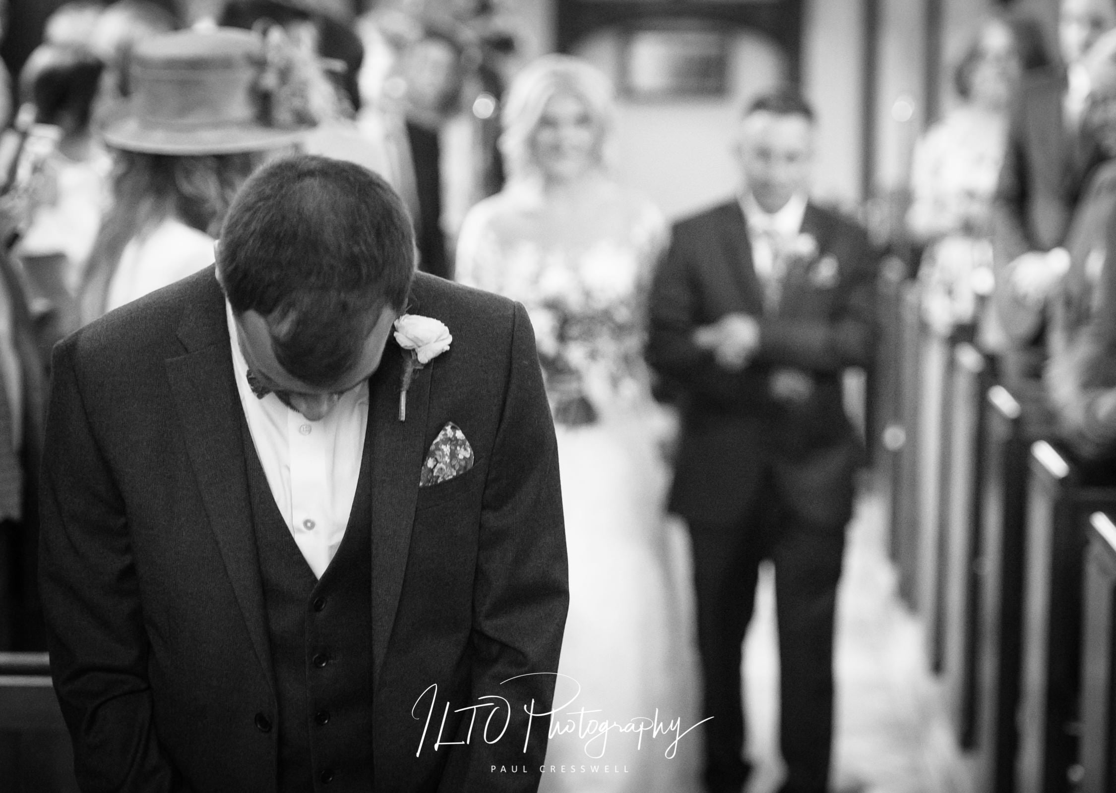emotional groom waiting for the bride
