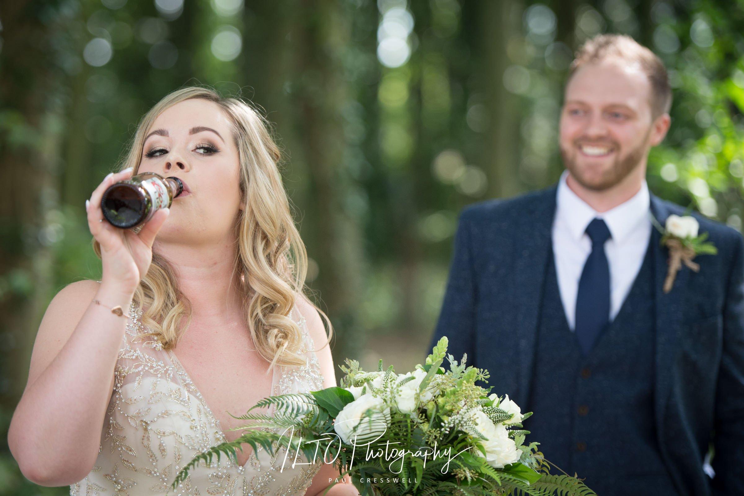 Wedding Portfolio, bride drinks beer, Leeds wedding photographer