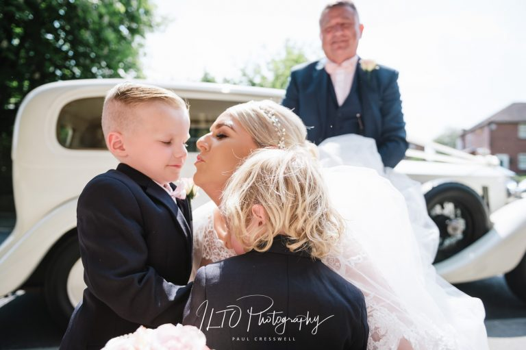 Wedding Portfolio, bride is greeted and kissed by her children