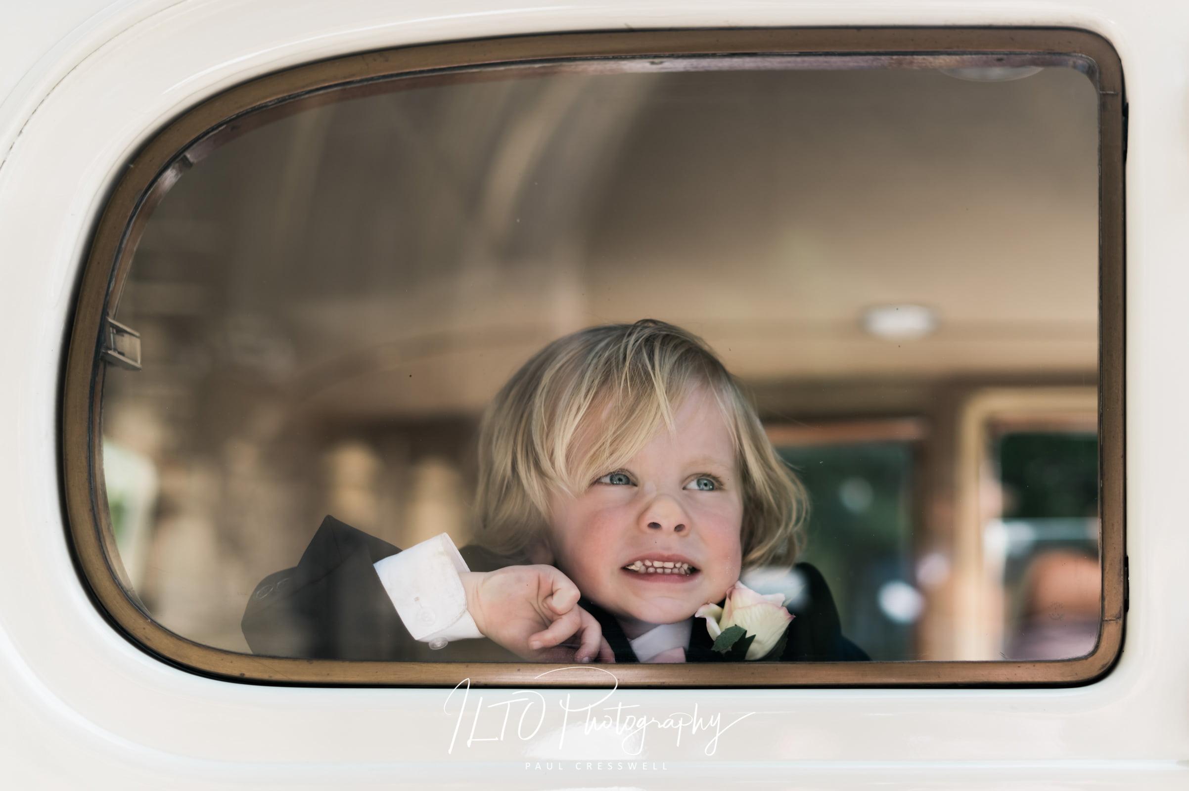 Wedding Portfolio, boy pressed wedding car window
