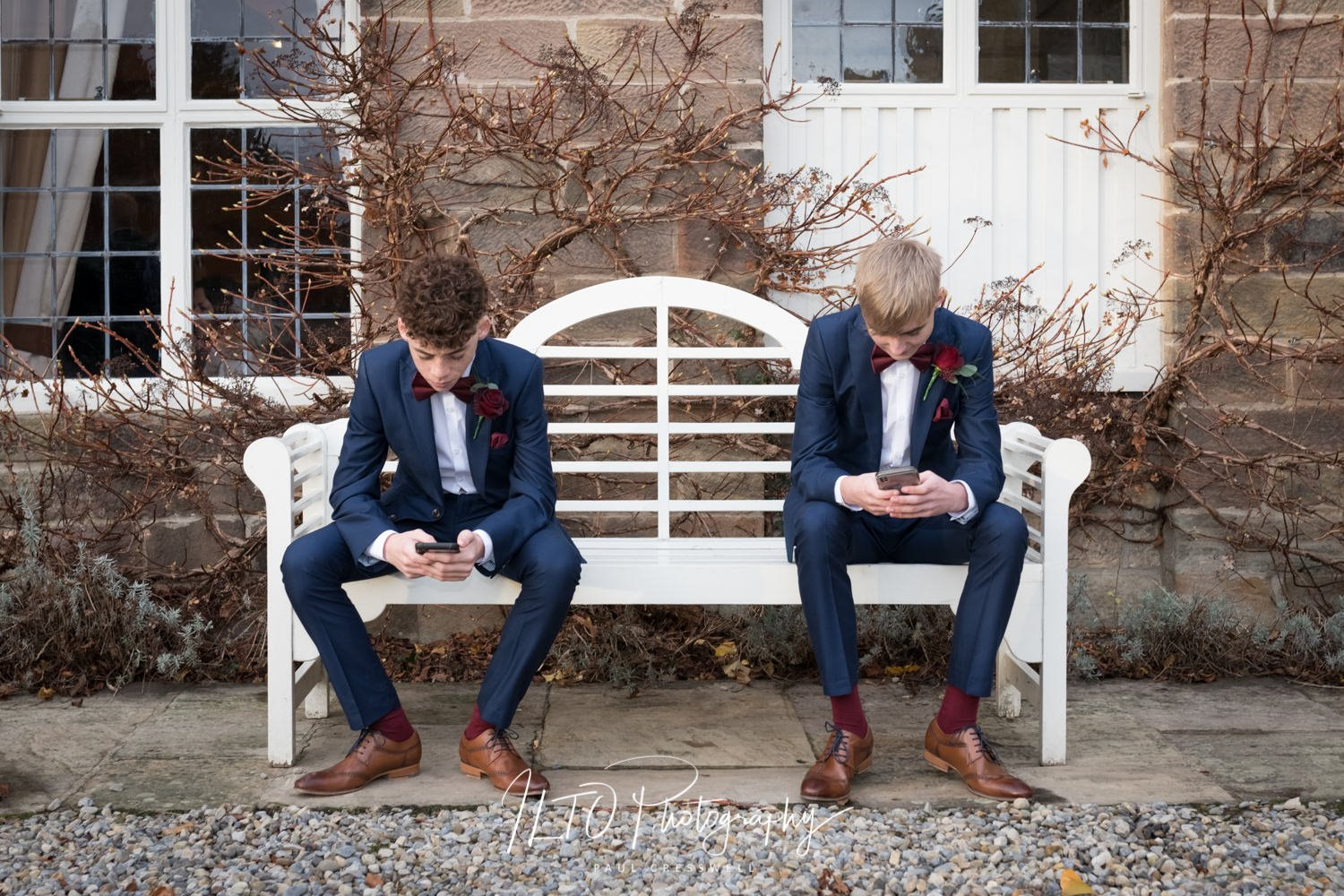 Teenagers on phones at a wedding