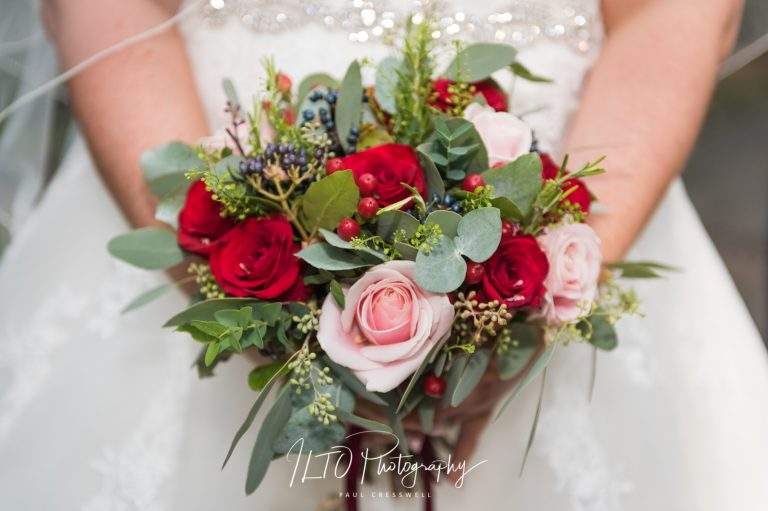 Red brides bouquet Wakefield Wedding Photographer