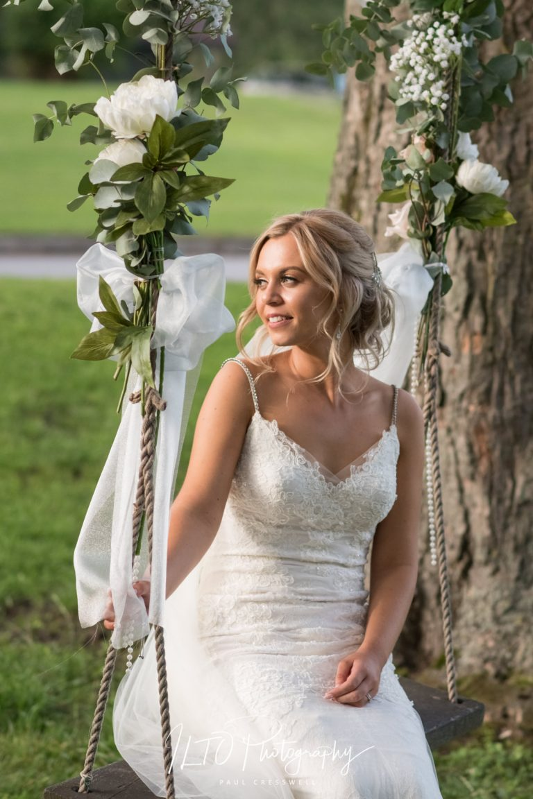 Bride on a swing Hollins Hall, wedding photographer leeds affordable