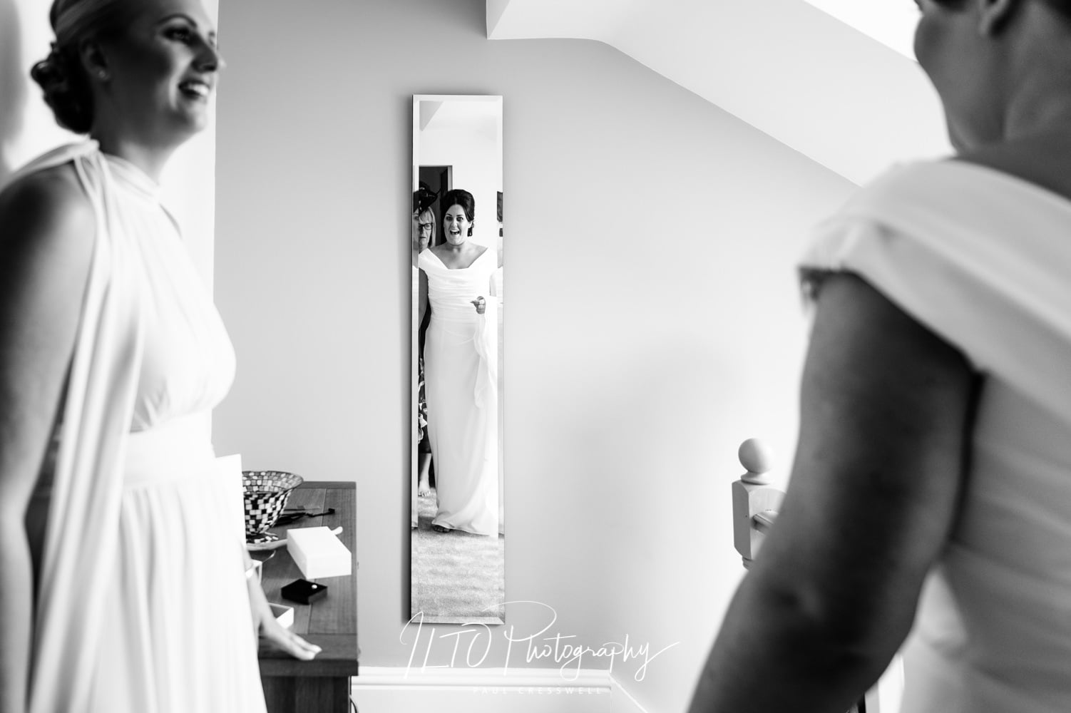 Excited bride sees herself in the mirror, yorkshire wedding photographer